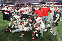 The OSU defense poses for a team photo after their 44-28 victory over Notre Dame in the Fiesta Bowl at University of Phoenix Stadium in Glendale, AZ on January 1, 2016.  (Chris Russell/Dispatch Photo)