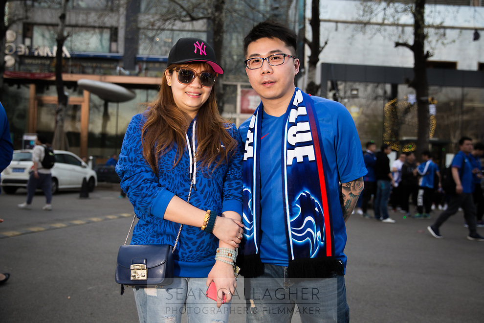Wang Yanlin (left), 30, and Duan Junxu (right), 34, fans of Chinese Super League football team Shanghai Shenhua wait outside the Worker's Stadium in Beijing before their team's game with Beijing Guo'an. 2nd April, 2017.