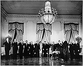 Swearing-In Ceremony of United States President John F. Kennedy's Cabinet in the East Room of the White House on January 21, 1961.   U.S. Chief Justice Earl Warren administers Oath to (L-R) Dean Rusk, Secretary of State;  Douglas Dillon, Secretary of the Treasury;  Robert S. McNamara, Secretary of Defense;  Robert F. Kennedy, Attorney General;  J. Edward Day, Postmaster General;  Stewart Udall, Secretary of Interior;   First Lady Jacqueline Kennedy;  U.S. President John F. Kennedy;  Adlai E. Stevenson, U.S. Representative to the United Nations;  Orville Freeman, Secretary of Agriculture;  (hidden: Luther Hodges, Secretary of Commerce) Arthur Goldberg, Secretary of Labor;  Abraham Ribicoff, Secretary of Health, Education & Welfare. ( In rear: Gen. C.V. Clifton, Military Aide;  Col. Godfrey McHugh, Air Force Aide;  Cmdr. Tazewell Shepard, Naval Aide ) .Credit: White House via CNP