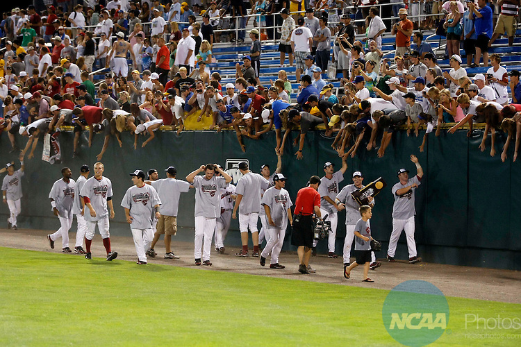 29 JUNE 2010:  The University of South Carolina celebrates their victory against UCLA with the fans during the Division I Men's Baseball Championship held at Rosenblatt Stadium in Omaha, NE.  South Carolina defeated UCLA 2-1 for the national title.  Jamie Schwaberow/NCAA Photos