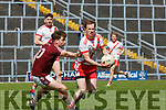 Padraig O Sé An Ghaeltacht is tackled by Dromid Sean O'Sé  during the Intermediate Championship semi final in Fitzgerald Stadium on Sunday