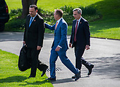 White House Director of Social Media Dan Scavino, left, Acting White House Chief of Staff Mick Mulvaney, center, and White House Counsel Pat Cipollone, right, walk across the South Lawn of the White House to join United States President Donald J. Trump and First lady Melania Trump on April 18, 2019 to spend the Easter weekend at his resort at Mar-a-Lago in Florida.  <br /> Credit: Ron Sachs / CNP<br /> (RESTRICTION: NO New York or New Jersey Newspapers or newspapers within a 75 mile radius of New York City)