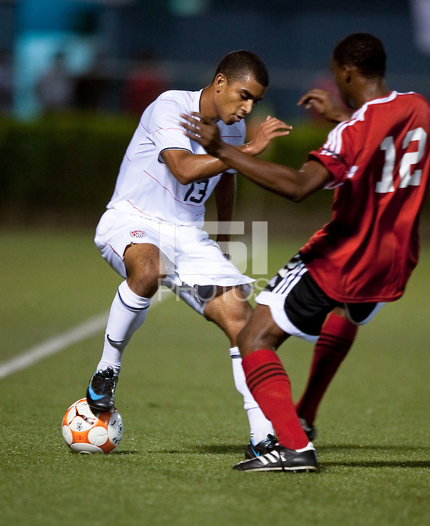 Taylor Alejandro (13) controls the ball against Robert Primus (12). US Under 20 Men's National Team played to a scoreless draw vs Trinidad & Tobago, advancing after winning 4-3 on penalty kicks at the Marvin Lee Stadium in Macoya, Trinidad on March 13th, 2009 during the 2009 CONCACAF U-20 Championship.