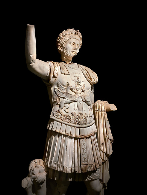 Roman statue of Emperor Trajan . Marble. Perge. 2nd century AD. Inv no . Antalya Archaeology Museum; Turkey. Against a black background.
