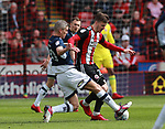 Steve Morison of Millwall tackles Lee Evans of Sheffield Utd during the championship match at the Bramall Lane Stadium, Sheffield. Picture date 14th April 2018. Picture credit should read: Simon Bellis/Sportimage