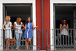 Young neighbors of the city of Valladolid watch from your balcony during a military parade marking the Armed Forces Day on June 2, 2012 in Valladolid.(ALTERPHOTOS/Acero)