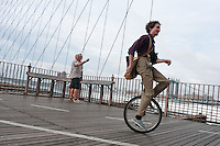 Brooklyn, NY -  3 September 2010 - Unicyclists cross the Brooklyn Bridge enroute to Coney Island during the Brooklyn Long Distance Unicycle Ride.