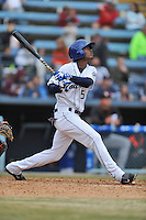 Asheville Tourists right fielder Raimel Tapia #15 swings at a pitch during a game against the  Delmarva Shorebirds at McCormick Field on April 6, 2014 in Asheville, North Carolina. The Shorebirds defeated the Tourists 4-2. (Tony Farlow/Four Seam Images)