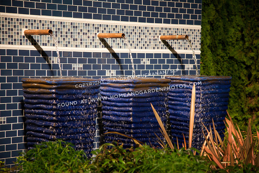 Water cascades from copper pipes into blue ceramic containers in this unique water feature.