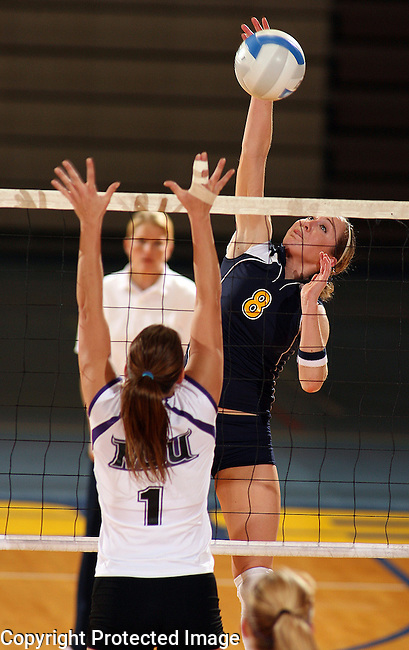 Augustana's Cayla Schroeder (8) kills the ball past Minnesota State University's Stef Sandstrom (1) during their match Friday night, October 19, 2007 at the Elmen Center in Sioux Falls. (photo by Dave Eggen/Inertia)