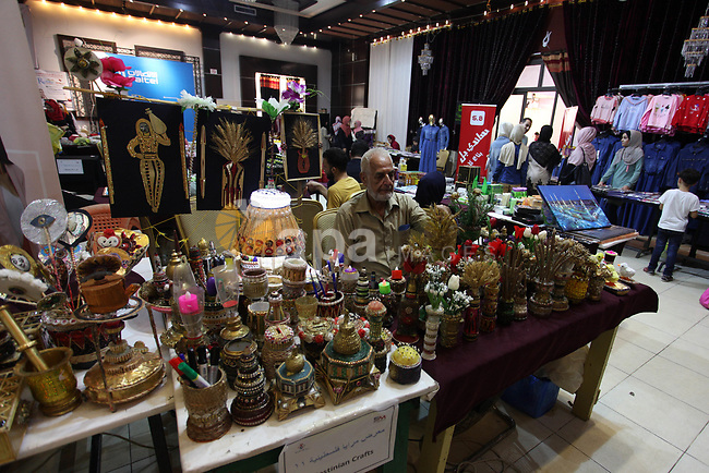 "Palestinians attend the exhibition of ""Palestinian Mirrors"" for traditional handmade crafts, in Gaza city on August 17, 2019. Photo by Mahmoud Ajjour"