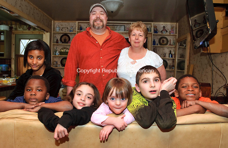 NAUGATUCK, CT, 06 APRIL 2011-040611JS02--Bob and Robin Kozloski of Naugatuck have been foster parents to many children including, from left, Jamara, 12; R.J., 5; Stephanie, 9; Emma, 2; Matthew, 13 and Taye, 7. who they adopted.<br /> Jim Shannon/Republican-American