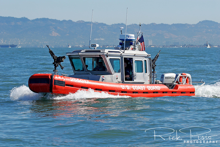 A Defender Class Response Boat (RB-S) displays its weapons along the San Francisco Waterfront during 2007 San Francisco Fleet Week activities. Armed with either an M-60 or M-240 machine gun the RB-S was designed as a homeland security and law enforcement platform to conduct escorts, enforce security zones, and deliver boarding teams.