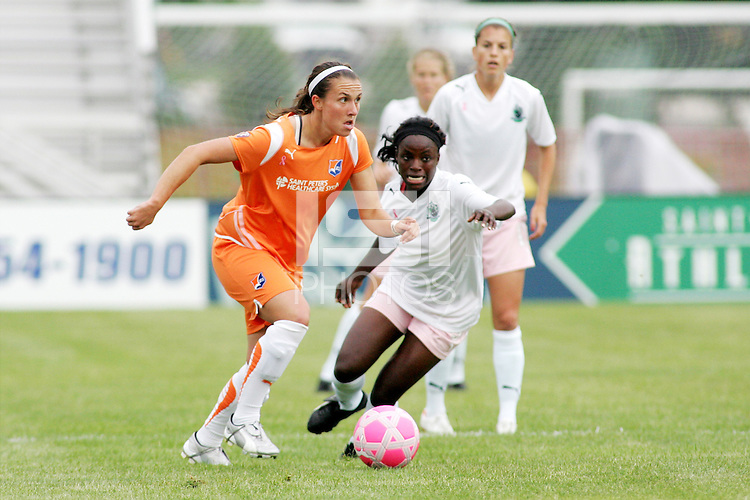 Meghan Schnur (orange) goes past Eniola Aluko...Saint Louis Athletica defeated Sky Blue FC 1-0 at Anheuser-Busch Soccer Park, Saint Louis, MO.