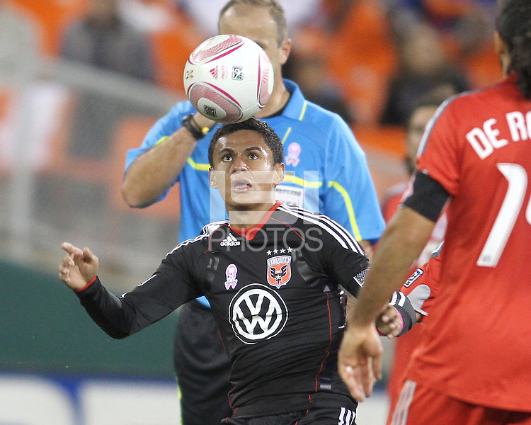 Andy Najar #14 of D.C. United heads the ball in front of Dwayne De Rosario #14 of Toronto FC during an MLS match that was the final appearance of D.C. United's Jaime Moreno at RFK Stadium, in Washington D.C. on October 23, 2010. Toronto won 3-2.