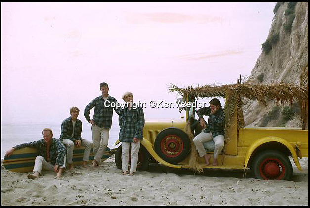 BNPS.co.uk (01202 558833)<br /> Pic: KenVeeder/RockawayRecords<br /> <br /> ****Please use full byline****<br /> <br /> A surfboard belonging to legendary Beach Boys drummer Dennis Wilson which featured on the covers of two of their most famous albums has emerged for sale for £100,000.<br /> <br /> The iconic blue and yellow board was used for the cover of the Beach Boys' groundbreaking debut album, 1962's Surfin' Safari, and again in 1963 on the front of Surfer Girl.<br /> <br /> Wilson, the band's only surfer, brought the 9ft board along to the band's first ever professional photo shoot held on a beach in California in 1962 shortly after they signed with Capitol Records.<br /> <br /> The five members - Brian, Dennis and Carl Wilson, their cousin Mike Love and friend Al Jardine - were snapped holding it while striking various poses on a beach. The photos from the session went on to become some of the most iconic images of the band.<br /> <br /> Wilson gave the board to his close friend Louis Marotta in the 1970s who in turn passed it on to Beach Boys fan Bob Stafford in 1985.<br /> <br /> Mr Stafford is now selling the board with a whopping price tag of £100,000 after a short stint on display at the Grammy Museum in Los Angeles to mark the band's 50th anniversary.