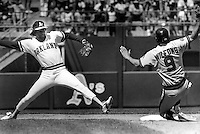 Oakland Athletics Alfredo Griffin steps on 2nd to force Angels Rob Wilfong. (1985 photo by Ron Riesterer)