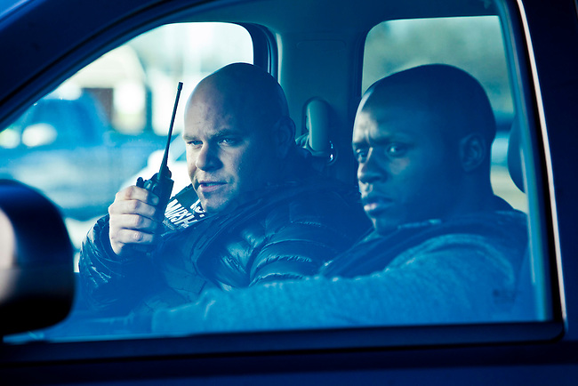 In this episode of Breakout Kings, Ray and Shea (Malcolm Goodwin) watch as Candice approaches Rodney's car. Ray reminds her again not to call attention to her wire.  Photo: Skip Bolen / A&E Television Networks