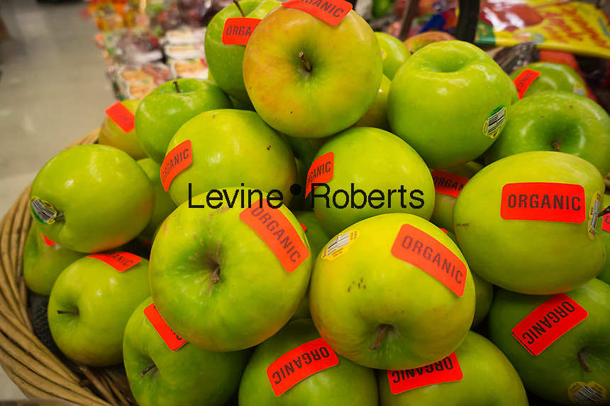 Organic apples are seen in a supermarket produce department in New York on Friday, March 23, 2012. (© Richard B. Levine)
