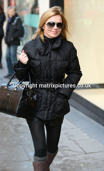 NON EXCLUSIVE PICTURE: MATRIXPICTURES.CO.UK.PLEASE CREDIT ALL USES..WORLD RIGHTS..British pop singer-songwriter Geri Halliwell is pictured leaving her house in North London...Geri looks glamorous with a large black handbag as she does a little window shopping...JANUARY 30th 2013..REF: MTX 13608
