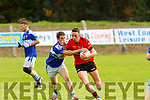 Tadhg McEllistrem Ballylongford seems to have a hand on the ball with Ambrose Lanigan Tarbert in Ballylongford on Sunday during the North Kerry Championship game.