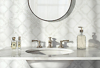 Eleanor, a waterjet stone mosaic, shown in honed Thassos and Shell, is part of the Bright Young Things™ collection by New Ravenna.