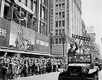 General George S. Patton acknowledging the cheers of the welcoming crowds in Los Angeles, CA, during his visit on June 9, 1945. Acme. (OWI)<br /> NARA FILE #:  208-PU-154F-5<br /> WAR & CONFLICT #:  753