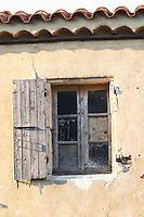 Chateau Mire l'Etang. An old window with wooden shutter. La Clape. Languedoc. Window. France. Europe.