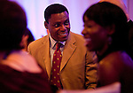 Olympic gold medalist, Carl Lewis, speaks to guests during the reception. Olympic gold medalist, Sanya Richards, and New York Giants cornerback, Aaron Ross, wed at the Hyde Park Baptist in Austin, Texas on Friday, February 26, 2010...