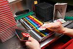 Thônex, le 13 mai 2013,société  Caran D Ache, fabricant de couleurs et de crayons, ainsi que de stylo haut de gamme, mise en boite des crayons de couleurs<br />  © sedrik nemeth