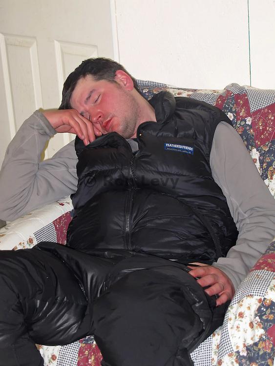 Musher Ray Redington Jr catches some sleep at Unalakleet checkpoint, Iditarod 2012, Alaska
