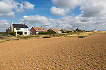 On the left is Ronina, former MOD house redesigned by Casswell Bank architects on beach at Shingle Street, Suffolk, England, UK