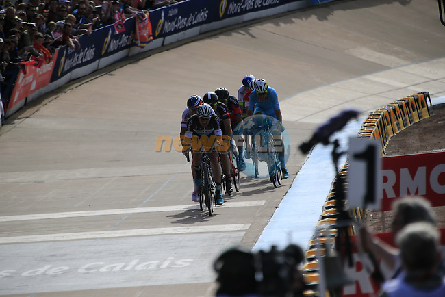 The lead group of riders with Yves Lampaert (BEL) and Zdenek Stybar (CZE) Etixx-Quick Step on the front enter the famous Roubaix Velodrome at the end of the 113th edition of the Paris-Roubaix 2015 cycle race held over the cobbled roads of Northern France. 12th April 2015.<br /> Photo: Eoin Clarke www.newsfile.ie
