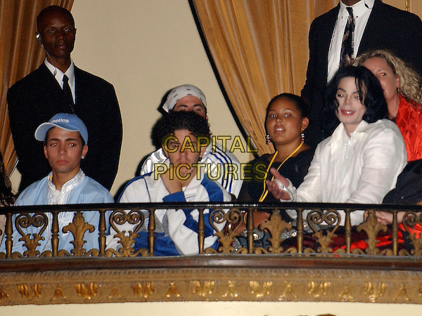 MICHAEL JACKSON & OMAR BHATTI.Singer Michael Jackson & Alleged son Omar Bhatti (blue baseball cap) at The MJ birthday party that was given by his fanclub at the Orpheum Theatre in Downtown L.A. California, USA, .August 30th 2003.half length balcony dead died blue cap hat white shirt wig hair 45th hand.CAP/DVS.©Debbie VanStory/Capital Pictures