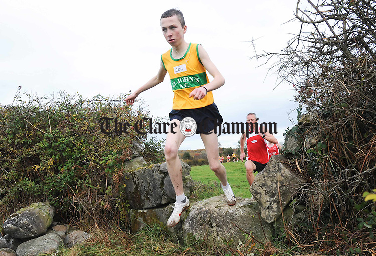 The senior men negotiate an obstacle at the Clare Cross Country Championships at Kilnaboy. Photograph by John Kelly...