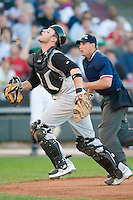 Kane County catcher Jacob Smith (13) chases a foul pop-up versus Dayton at Fifth Third Field in Dayton, OH, Monday, May 7, 2007.