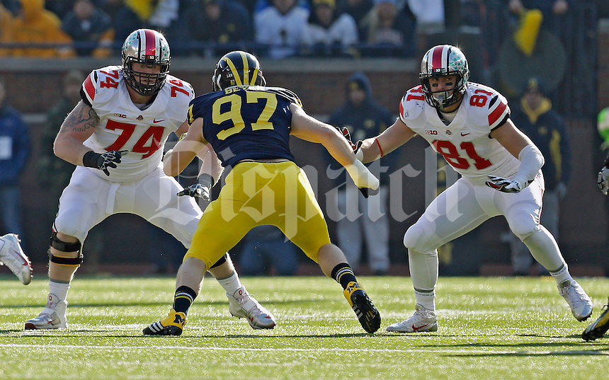 Ohio State Buckeyes offensive linesman Jack Mewhort (74) and Ohio State Buckeyes tight end Nick Vannett (81) against Michigan Wolverines during their college football game at Michigan Stadium in Ann Arbor, Michigan on November 30, 2013.  (Dispatch photo by Kyle Robertson)