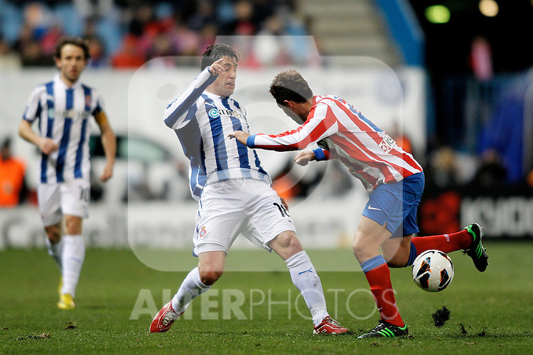 Atletico de Madrid's Gabi and Espanyol's Capdevila during La Liga  match. February 24,2013.(ALTERPHOTOS/Alconada)