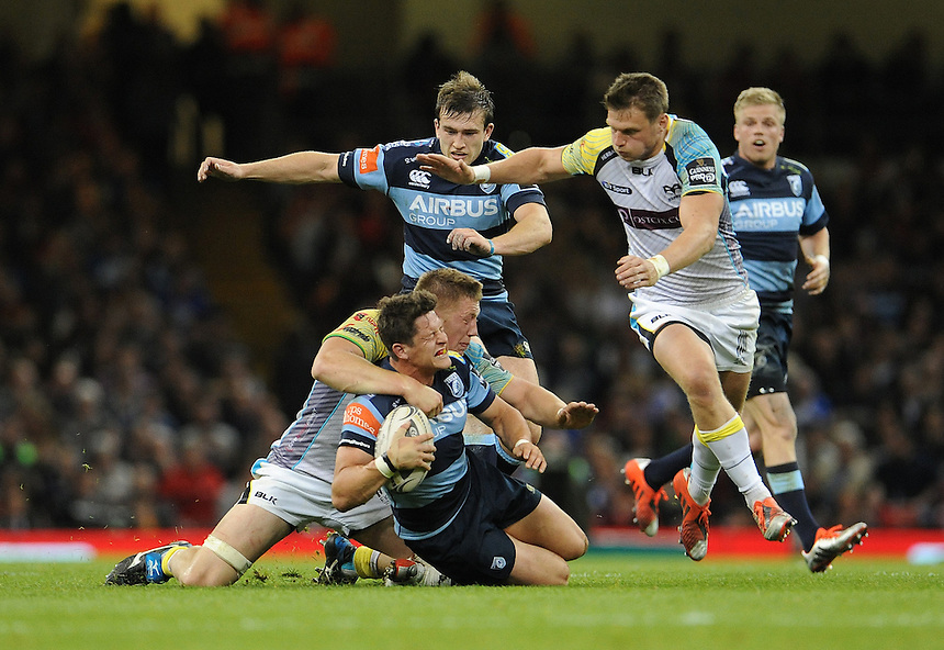 Cardiff Blues' Lloyd Williams is tackled by Ospreys' Lloyd Peers<br /> <br /> Photographer Ian Cook/CameraSport<br /> <br /> Rugby Union - Guinness PRO12 - Saturday 25th April 2015 - Cardiff Blues v Ospreys - Millennium Stadium - Cardiff<br /> <br /> &copy; CameraSport - 43 Linden Ave. Countesthorpe. Leicester. England. LE8 5PG - Tel: +44 (0) 116 277 4147 - admin@camerasport.com - www.camerasport.com