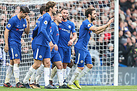 Eden Hazard of Chelsea (centre) celebrates after he scores his team's third goal of the game to make the score 3-1 during the Premier League match between Chelsea and Newcastle United at Stamford Bridge, London, England on 2 December 2017. Photo by David Horn.