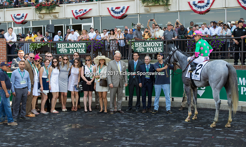 ELMONT, NY - JUNE 10: Disco Partner #2, ridden by Irad Ortiz Jr.,poses for a photograph in the winner's circle after winning with the connections on Belmont Stakes Day at Belmont Park on June 10, 2017 in Elmont, New York (Photo by Sue Kawczynski/Eclipse Sportswire/Getty Images)