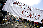 Abolish money banner.<br /> Anti capitalist / greed demonstration in front of the Bank of England. Thousands of protesters marched on the Bank of England in the city of London during the G20 conference meeting, London April 2009 , RBS  Bank windows were smashed on the ground floor.  Police made around 90 arrests.