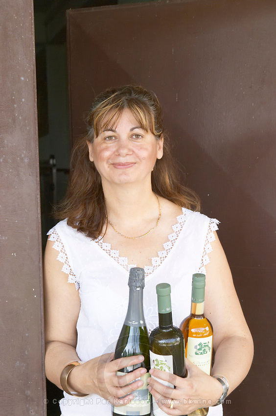 Olivera Juricic, the owner, holding bottles from the winery. Vita@I Vitaai Vitai Gangas Winery, Citluk, near Mostar. Federation Bosne i Hercegovine. Bosnia Herzegovina, Europe.