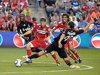 AC Milan midfielder Davide Di Gennaro (49) attempts to poke the ball away from Chicago Fire midfielder Logan Pause (12).  AC Milan defeated the Chicago Fire 1-0 at Toyota Park in Bridgeview, IL on May 30, 2010.