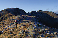 A walker climbing towards Am Bodach and the Aonach Eagach above Glencoe, Highlands.<br /> <br /> Copyright www.scottishhorizons.co.uk/Keith Fergus 2011 All Rights Reserved