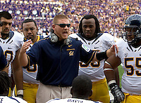 California defensive line coach Tosh Lupoi talks with his players during the game against Washington at Seattle, Washington on September 24th, 2011.  Washington defeated California 31-23.