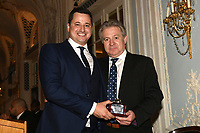 General secretary of the BBBofC Robert Smith (R) is presented with an award by Andy Scott during the Boxing Writers Club Annual Dinner at the Savoy Hotel on 7th October 2019