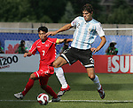 06 July 2007: Argentina's Frederico Fazio (2) looks to control the ball in front of North Korea's Kum Il Kim (7). Argentina's Under-20 Men's National Team defeated North Korea's Under-20 Men's National Team 1-0 in a Group E opening round match at Frank Clair Stadium in Ottawa, Ontario, Canada during the FIFA U-20 World Cup Canada 2007 tournament.