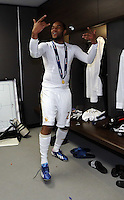 Pictured:  Kemy Agustien celebrating in the changing room. Sunday 24 February 2013<br /> Re: Capital One Cup football final, Swansea v Bradford at the Wembley Stadium in London.