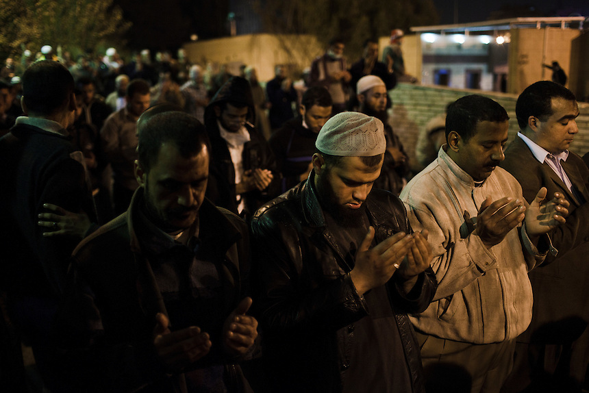 Egyptian men perform evening prayers during protests in Cairo's Tahrir, Novemebr 21, 2011. Photo: Ed Giles.
